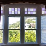 Double glazed windows with coloured glass inserts